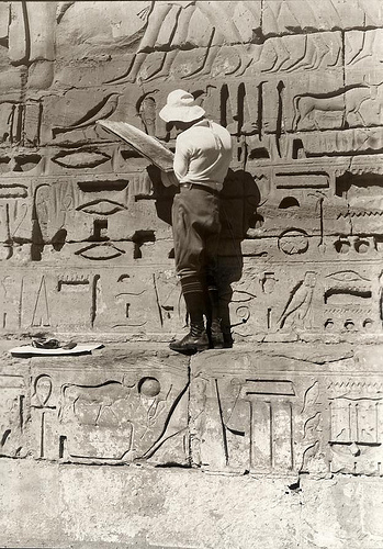 A tourist studying Egyptian hieroglyphs